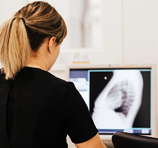 Radiologist looking at Xray